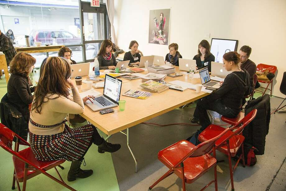 """Volunteers at an Art and Feminism Wikipedia Edit-a-thon. Wikipedia, created to be """"the people's dictionary"""" turned 18 this week. It now contains more than 48 million articles in some 300 languages. Photo: Michael Mandiberg"""