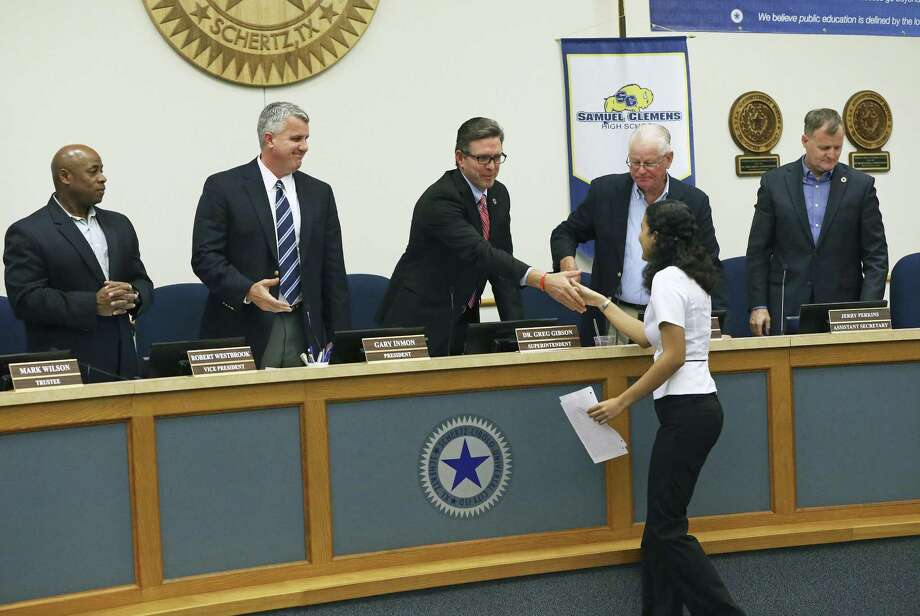 Steele High School senior Nyssa Miller gets a handshake from Superintendent Greg Gibson as the Schertz-Cibolo-Universal City board of trustees meets at the district headquarters on February 16, 2017. Miller was recognized for achievements including her perfect score of 36 on the ACT test. Photo: Tom Reel, Staff / San Antonio Express-News / 2017 SAN ANTONIO EXPRESS-NEWS