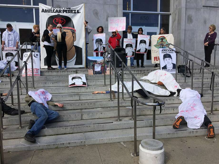 Activists stage a die-in at San Francisco's Hall of Justice on Monday, Feb. 27, 2017, in honor of the two-year anniversary of Amilcar Perez-Lopez's death. Perez-Lopez, 21, was fatally shot by two San Francisco police officers in the Mission District on Feb. 26, 2015. Photo: Vivian Ho, San Francisco Chronicle