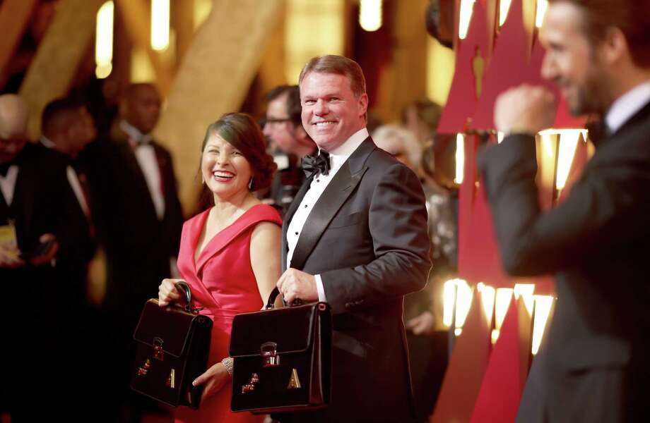 Martha Ruiz and Brian Cullinan, two representatives from PwC, formerly known as PricewaterhouseCoopers, were all smiles Sunday night before something went very wrong at the Academy Awards. Photo: Christopher Polk, Staff / 2017 Getty Images