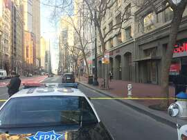 Police shut down a block of San Francisco's Market Street on Monday afternoon, Feb. 27, 2017, because of a bomb threat phoned into the offices of the Anti-Defamation League.