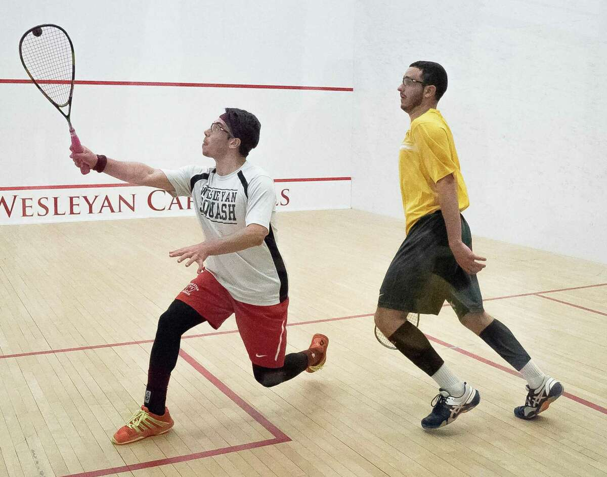 Norwalk resident Alex Kamisher, left, was a senior member of the Wesleyan University men's squash this season. For the third time overall, and the first time since 1992, the 26th-ranked Wesleyan University men's squash team won the Conroy Cup (D Division) at the College Squash Association (CSA) National Team Championships.