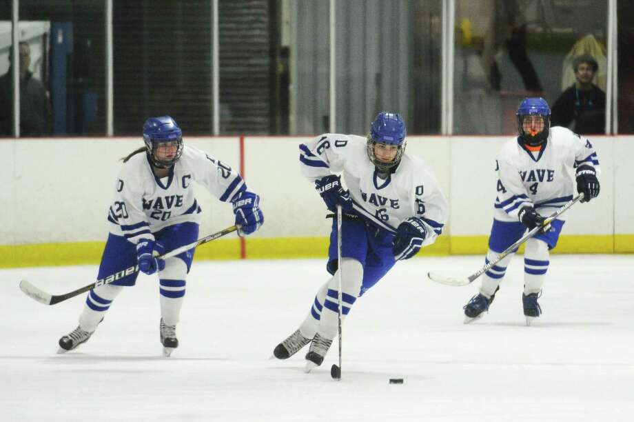 Darien sophomore forward Shea van den Broek leads an offensive charge flanked by senior forward Cassidy Schiff, left, and Libby Branca during the girls varsity hockey state quarterfinals game against New Canaan at Darien Ice Rink in Darien, Conn. on Monday, Feb. 27, 2017. Photo: Michael Cummo / Hearst Connecticut Media / Stamford Advocate