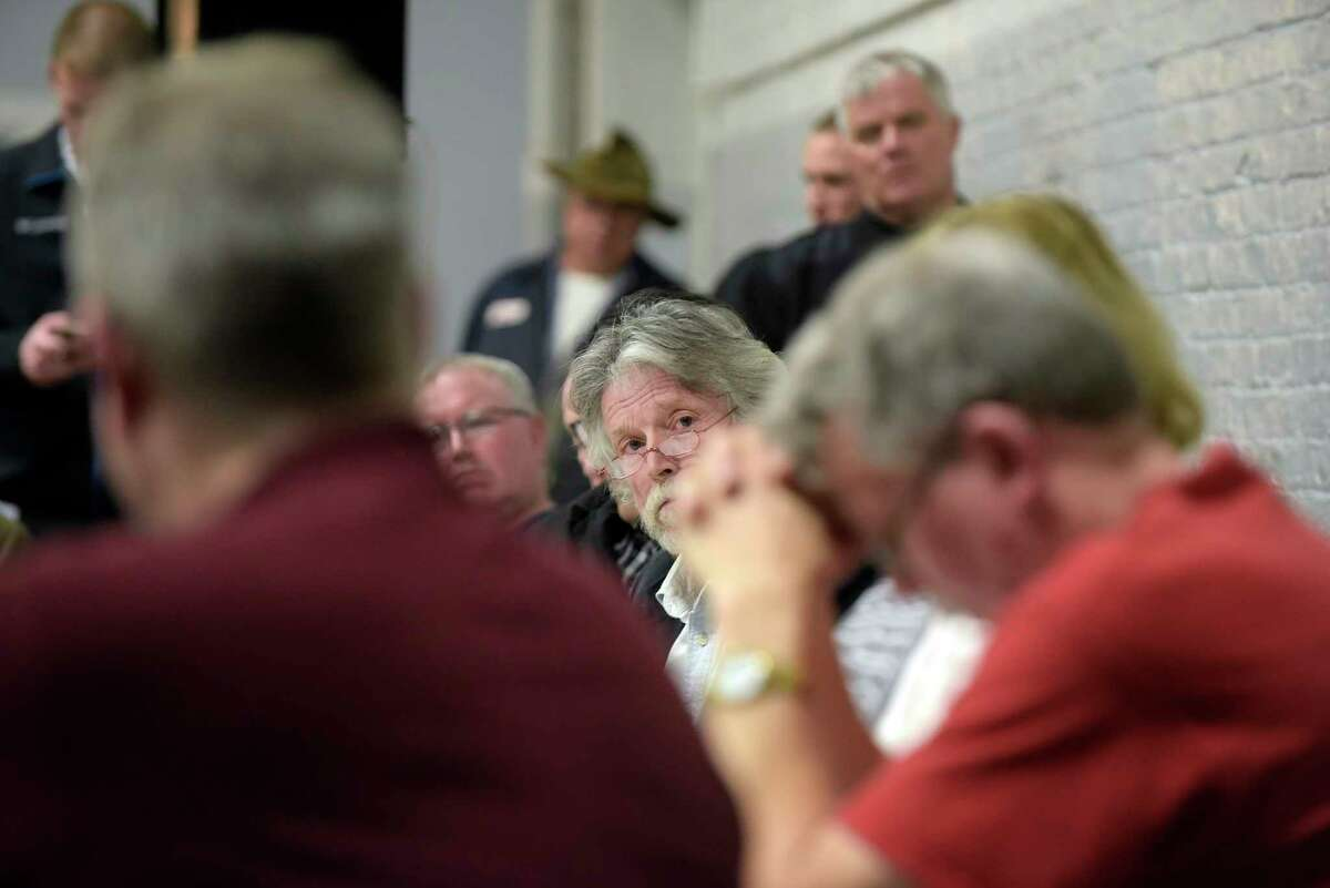 Hoosick Falls Mayor David Borge, center, and Village Board Members listen to residents speak in opposition to a revised proposed PFOA settlement during a board meeting on Monday, Feb. 27, 2017, in Hoosick Falls, N.Y. (Paul Buckowski / Times Union)