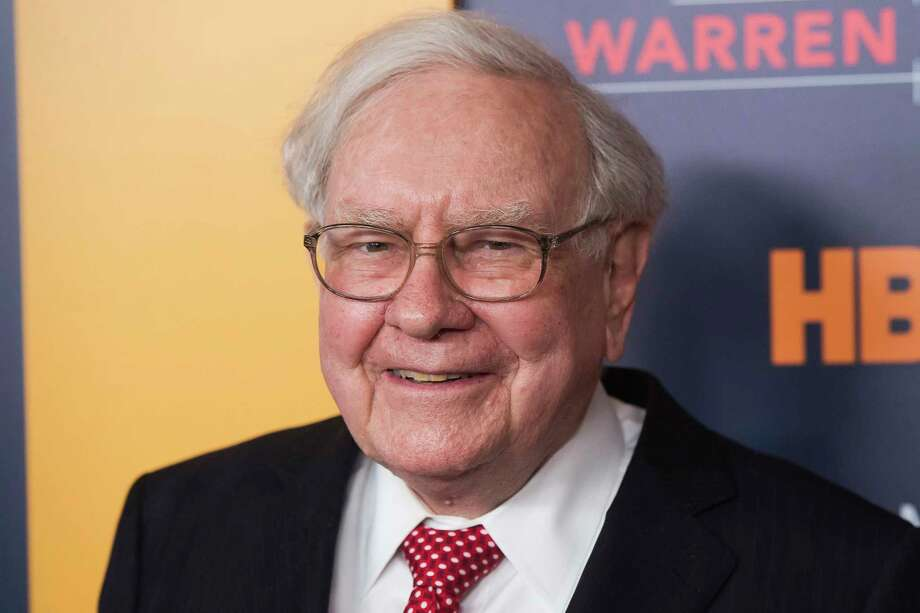 """FILE - In this Thursday, Jan. 19, 2017, file photo, Warren Buffett attends the world premiere screening of HBO's """"Becoming Warren Buffett"""" at The Museum of Modern Art in New York.  Buffett said he's investing heavily in Apple, believing that once consumers begin using  the company's products they aren't likely to stop. Buffett said on CNBC Monday, Feb. 27, 2017, that Berkshire Hathaway holds about 133 million shares of Apple after buying more stock earlier this year. (Photo by Charles Sykes/Invision/AP, File) Photo: Charles Sykes, INVL / 2017 Invision"""
