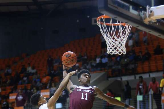 North Forest's Kardell Edwards, left, resorts to a foul to stop a dunk by Silsbee's Willie Jones.