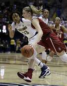 Stanford's Karlie Samuelson, right, drives the ball past California's Jaelyn Brown during the first half of an NCAA college basketball game Thursday, Feb. 16, 2017, in Berkeley, Calif. (AP Photo/Ben Margot)