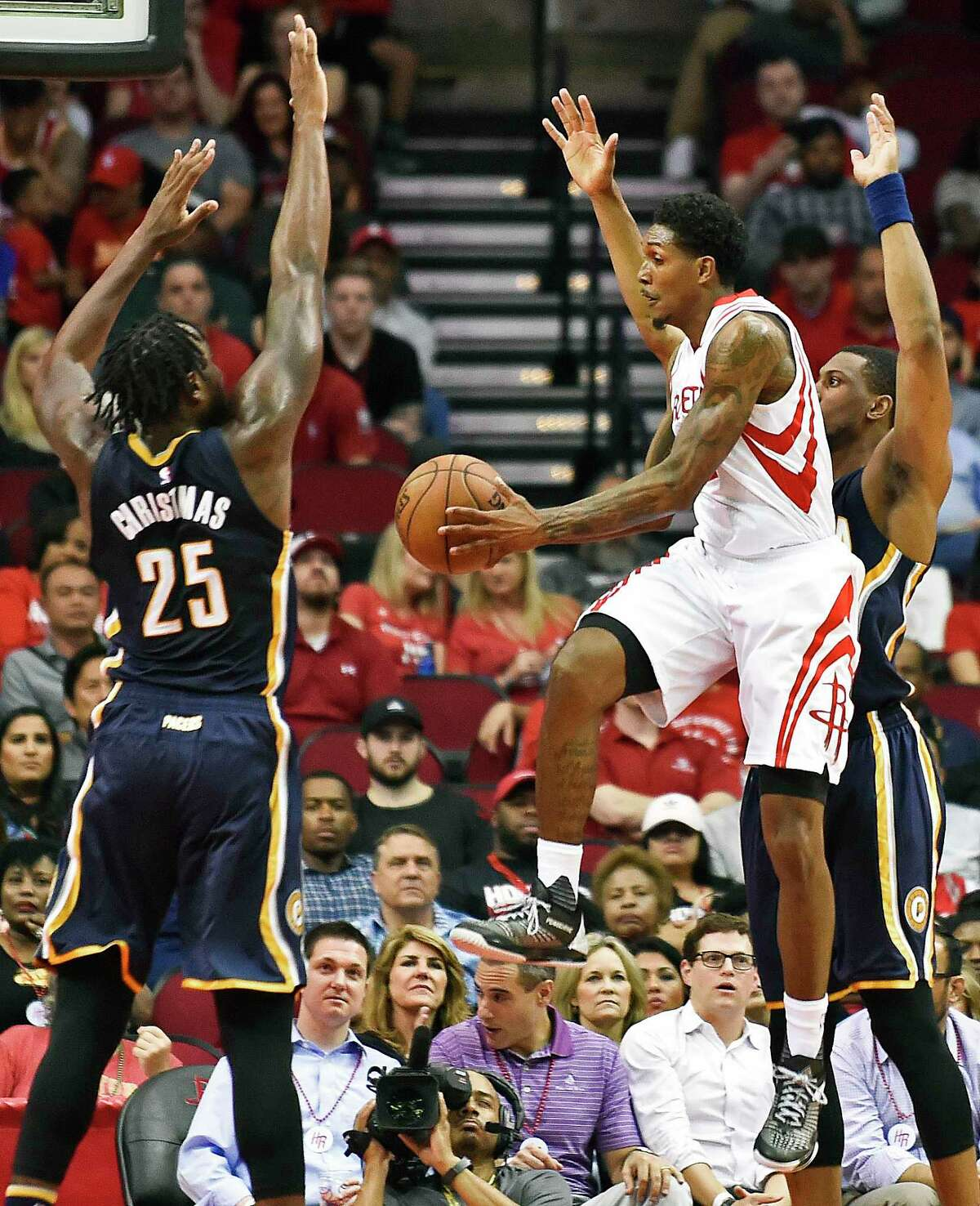 Houston Rockets guard Louis Williams, center, looks to pass as Indiana Pacers forwards Rakeem Christmas (25) and Thaddeus Young defend in the first half of an NBA basketball game, Monday, Feb. 27, 2017, in Houston. (AP Photo/Eric Christian Smith)