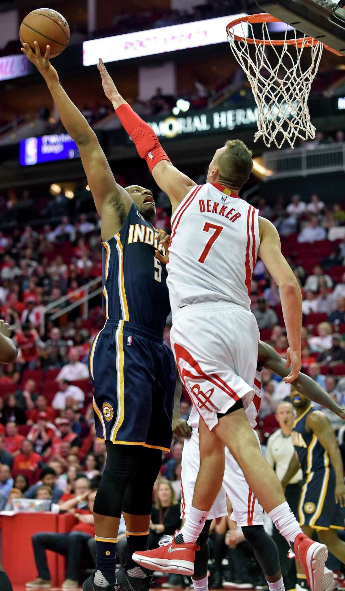 Indiana Pacers forward Lavoy Allen (5) shoots over Houston Rockets forward Sam Dekker (7) in the first half of an NBA basketball game, Monday, Feb. 27, 2017, in Houston. (AP Photo/Eric Christian Smith)