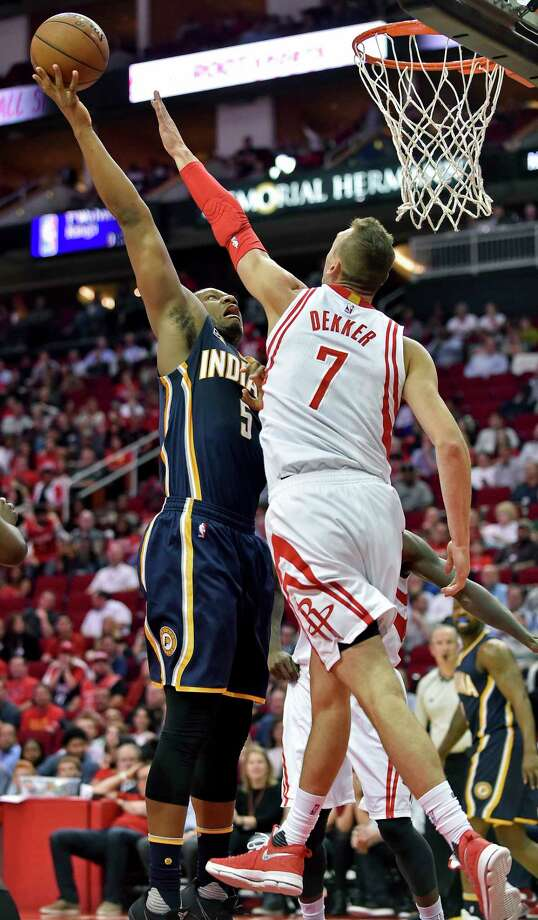 Indiana Pacers forward Lavoy Allen (5) shoots over Houston Rockets forward Sam Dekker (7) in the first half of an NBA basketball game, Monday, Feb. 27, 2017, in Houston. (AP Photo/Eric Christian Smith) Photo: Eric Christian Smith, Associated Press / FR171023 AP