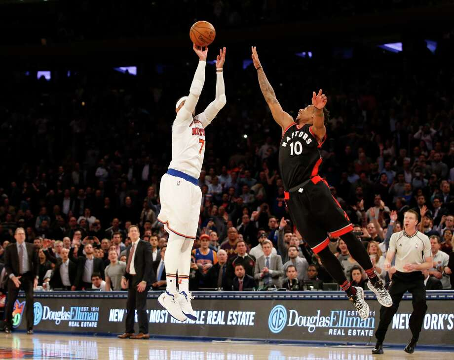 New York Knicks forward Carmelo Anthony (7) takes a last second shot as Toronto Raptors guard DeMar DeRozan (10) defends it in the fourth quarter of an NBA basketball game at Madison Square Garden in New York, Monday, Feb. 27, 2017. Anthony missed the shot and the Raptors defeated the Knicks 92-91. (AP Photo/Kathy Willens) ORG XMIT: MSG108 Photo: Kathy Willens / Copyright 2017 The Associated Press. All rights reserved.
