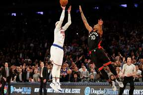 New York Knicks forward Carmelo Anthony (7) takes a last second shot as Toronto Raptors guard DeMar DeRozan (10) defends it in the fourth quarter of an NBA basketball game at Madison Square Garden in New York, Monday, Feb. 27, 2017. Anthony missed the shot and the Raptors defeated the Knicks 92-91. (AP Photo/Kathy Willens) ORG XMIT: MSG108
