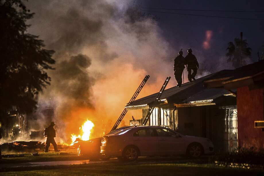 Smoke rises from a fire after a plane crashed into homes in Riverside, Calif., Monday, Feb. 27, 2017. Three people aboard the plane were killed, and two others survived. Photo: Watchara Phomicinda, Associated Press