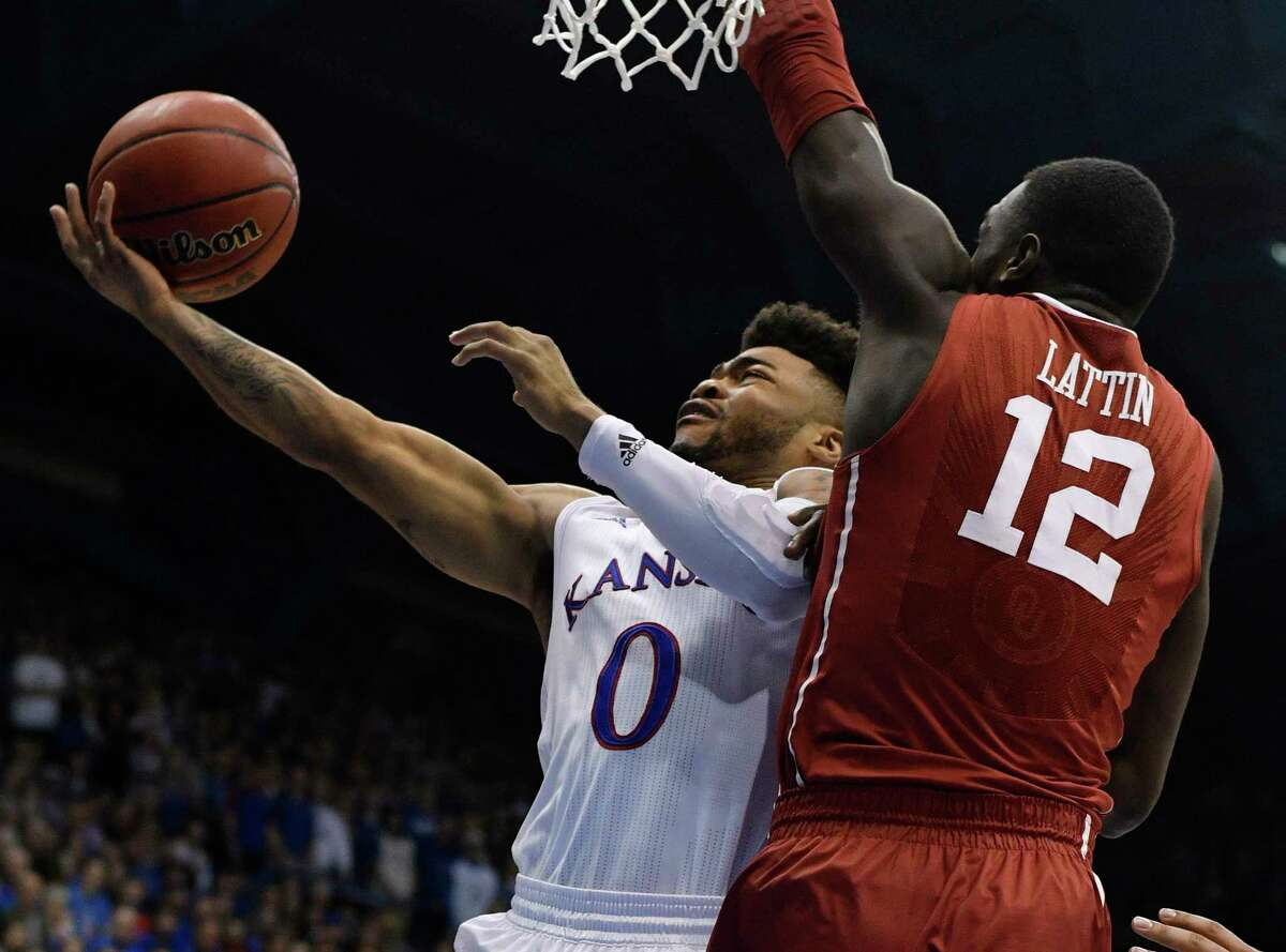 LAWRENCE, KS - FEBRUARY 27: Frank Mason III #0 of the Kansas Jayhawks lays the ball up against Khadeem Lattin #12 of the Oklahoma Sooners in the first half at Allen Fieldhouse on February 27, 2017 in Lawrence, Kansas. (Photo by Ed Zurga/Getty Images) ORG XMIT: 669708731