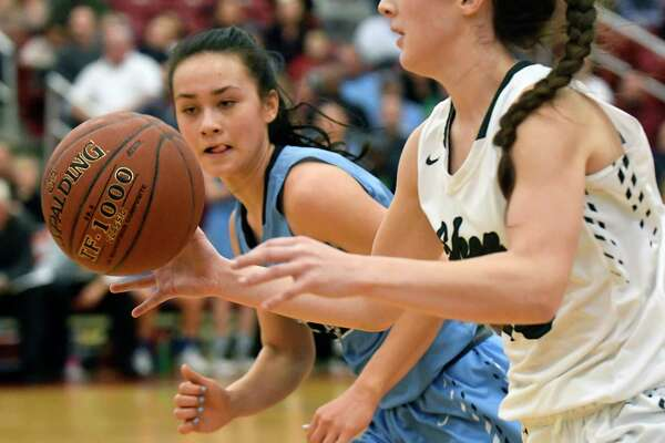 Shenendehowa's Cameron Tooley (23) moves the ball in front of Columbia's Emily Zeyak (20) during the second half of a Section II Class AA girls' basketball quarterfinal game on Monday, Feb. 27, 2017, in Guilderland, N.Y. (Hans Pennink / Special to the Times Union) ORG XMIT: HP108
