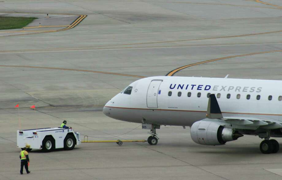 A United Express flight operated by Mesa Airlines is pushed back from its gate at Bush Intercontinental Airport in February 2017. Photo: Bill Montgomery, Houston Chronicle