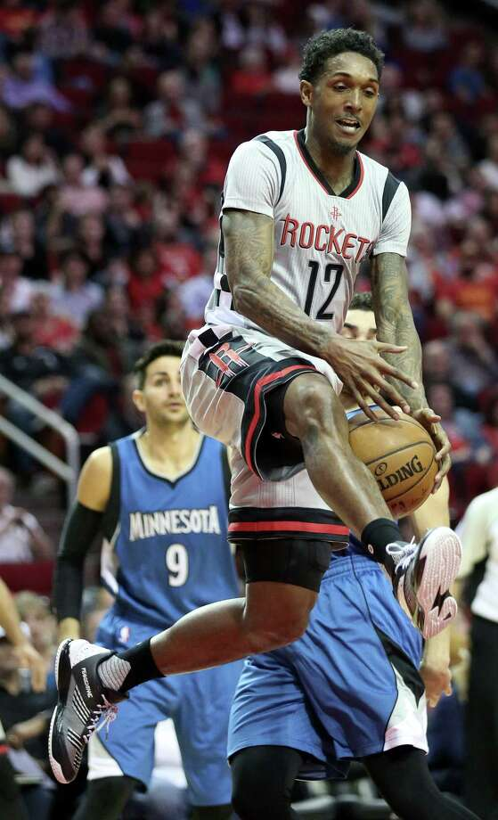 Houston Rockets guard Lou Williams (12) tries to make a pass under the basket during the first half of the game at Toyota Center Saturday, Feb. 25, 2017, in Houston. ( Yi-Chin Lee / Houston Chronicle ) Photo: Yi-Chin Lee, Staff / © 2017  Houston Chronicle
