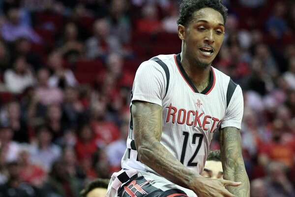 Houston Rockets guard Lou Williams (12) tries to make a pass under the basket during the first half of the game at Toyota Center Saturday, Feb. 25, 2017, in Houston. ( Yi-Chin Lee / Houston Chronicle )