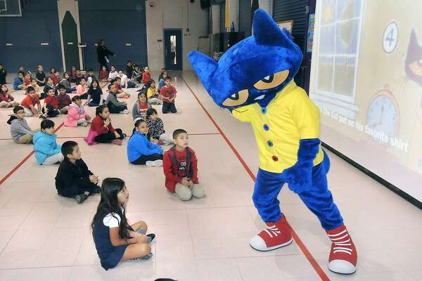 "In this March 3, 2015 file photo, students at Perez Elementary got a visit from storybook character ""Pete the Cat"" as they participated in a rally celebrating National Read Across America Week and author Dr. Seuss' birthday. The rally was intended to inspire students to adopt reading as part of their lifestyle and to create interest in the campus library program."