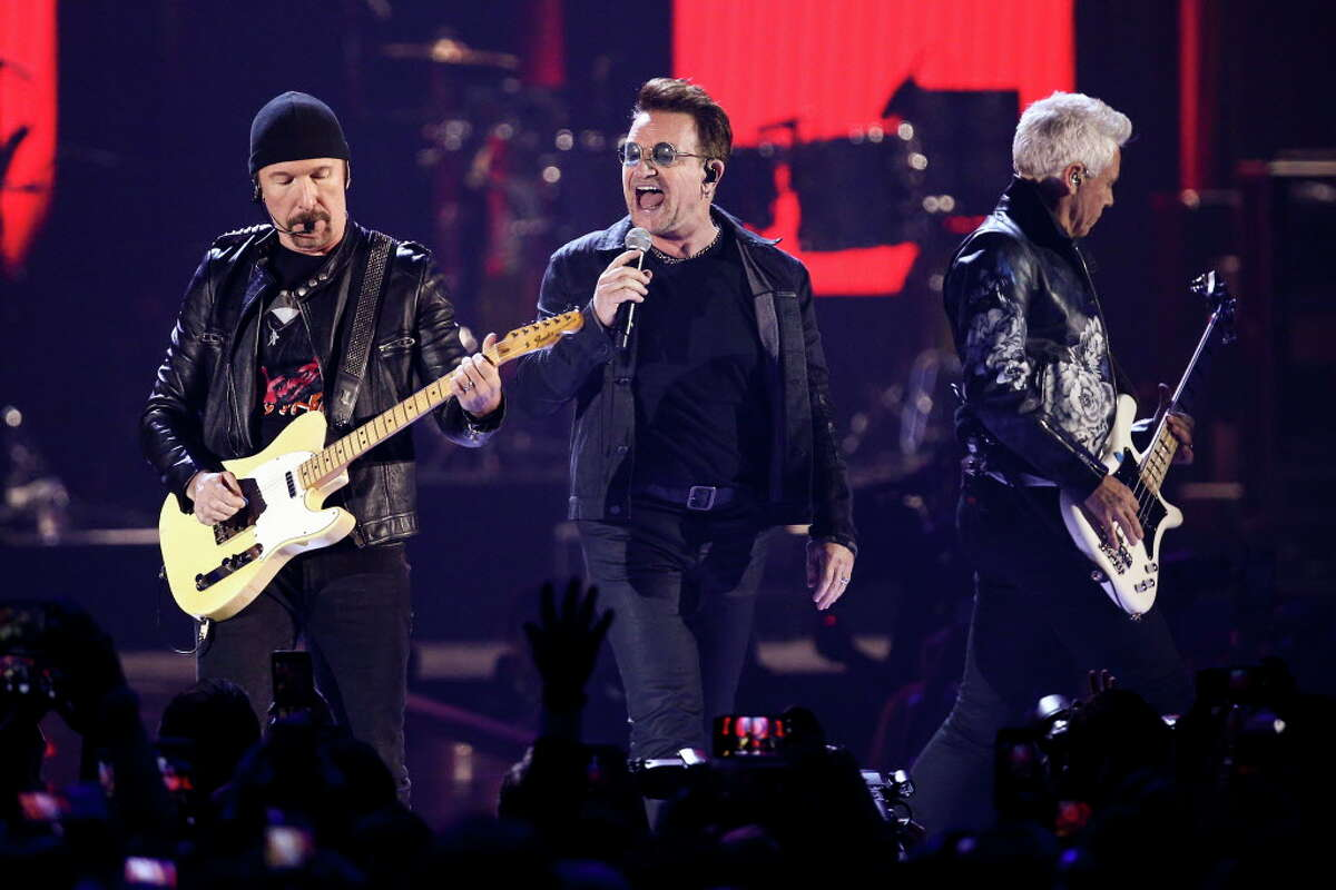 FILE - In this Sept. 23, 2016, file photo, The Edge, from left, Bono and Adam Clayton of the music group U2 perform at the 2016 iHeartRadio Music Festival at T-Mobile Arena in Las Vegas. U2 announced Jan. 9, 2017, that it will play the entirety of its classic 1987 album ?