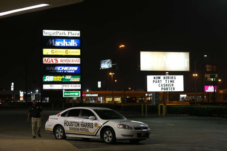 A security guard patrols a parking lot off Wilcrest near the Southwest Freeway after a woman was killed by suspected carjackers on Tuesday, Feb. 28, 2017, in Houston. Around 9 p.m. on Monday, the driver of a green Jeep Commander was carjacked at West Bellfort and Kirkwood. The suspects, two black men sped off in the Jeep and crashed with a white Ford Explorer a short time later. The driver of the stolen Jeep got out and opened fire on the Explorer where the woman was sitting in the passenger seat. Her husband and two small children were also in the vehicle. Photo: J. Patric Schneider, Houston Chronicle