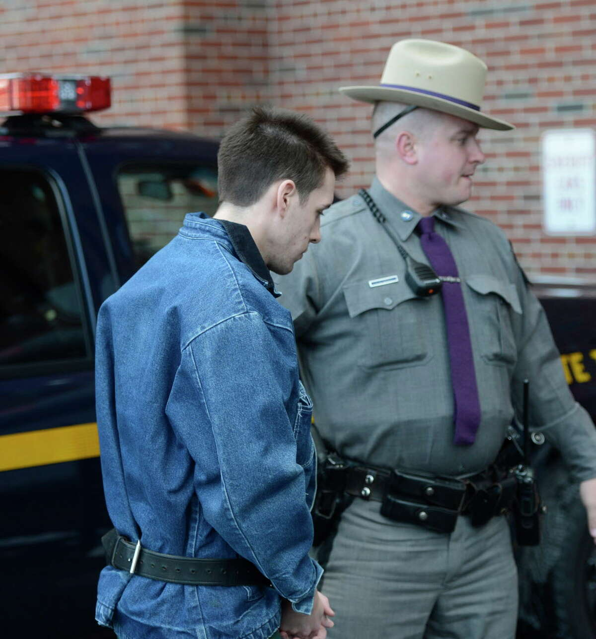Dennis Drue, age 22, is led from a State Police car Monday, Jan. 7, 2013, to the Saratoga County Courthouse in Ballston Spa, N.Y. Drue allegedly drove the car which rear-ended an SUV killing two popular Shenendehowa High School students on the Northway last Dec. (Skip Dickstein/Times Union)