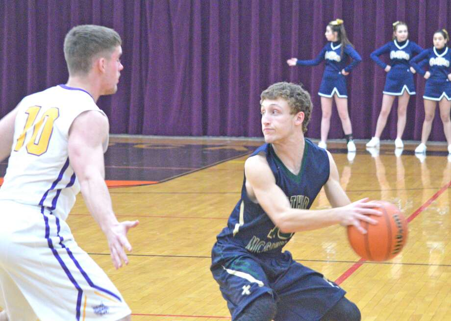 Father McGivney senior Derek Shearer, right, is guarded by Mount Olive's Joey Baum during Monday's first-round game at the Class 1A Mount Olive Regional.