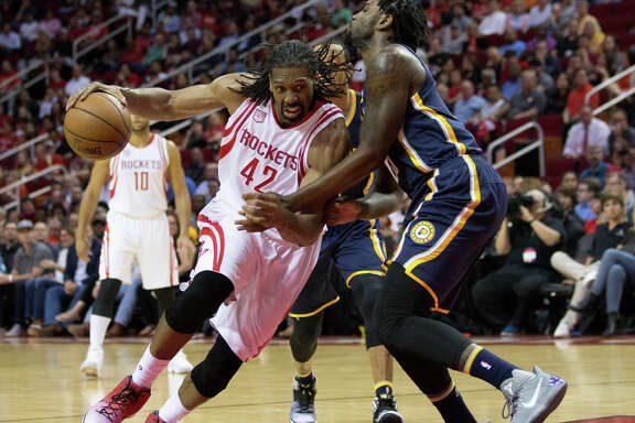 HOUSTON, TX - FEBRUARY 27:  Nene #42 of the Houston Rockets drives around Rakeem Christmas #25 of the Indiana Pacers in the second quarter at Toyota Center on February 27, 2017 in Houston, Texas.