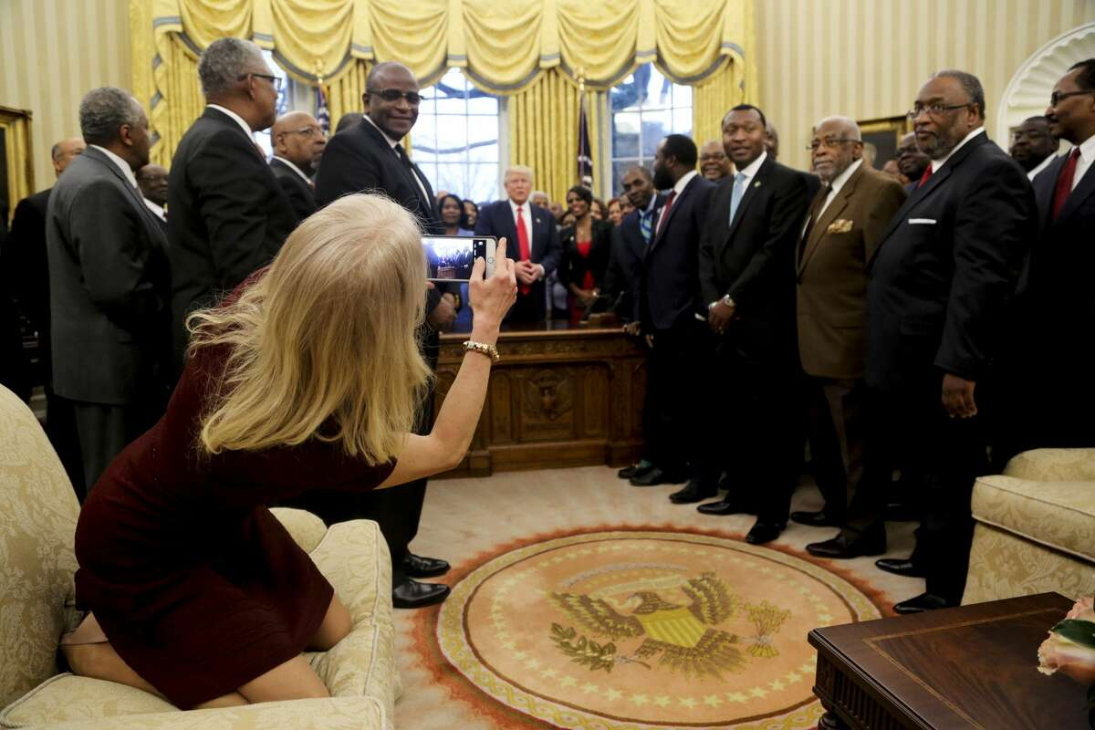 Counselor to the President Kellyanne Conway takes a picture of U.S. President Donald Trump with members of the Historically Black Colleges and Universities in the Oval Office of the White House, on February 27, 2017 in Washington, DC.