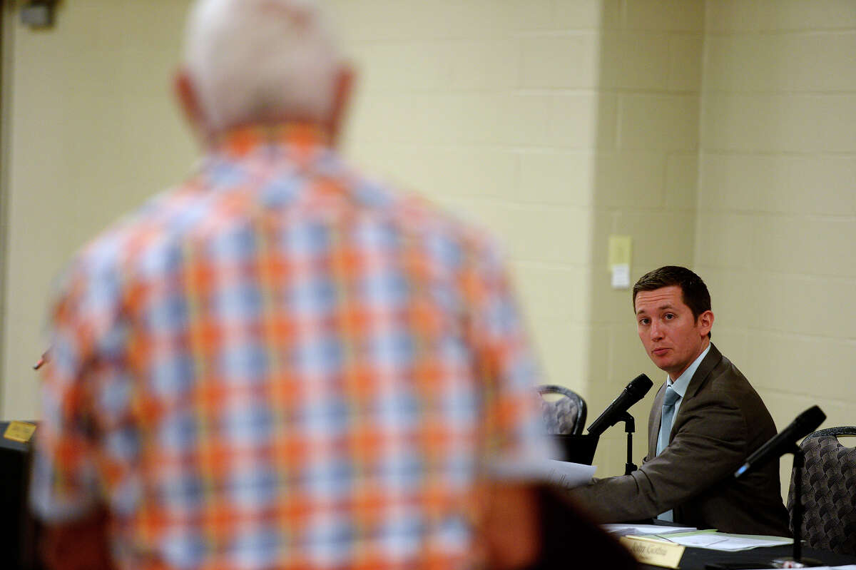 Orange County Judge Stephen Brint Carlton listens as Woodrow Dugas asks a question during a town hall meeting Monday evening on the county's $3.175 million settlement in the death of Robert Montano, who died in the Orange County jail in 2011. Photo taken Monday 2/27/17 Ryan Pelham/The Enterprise