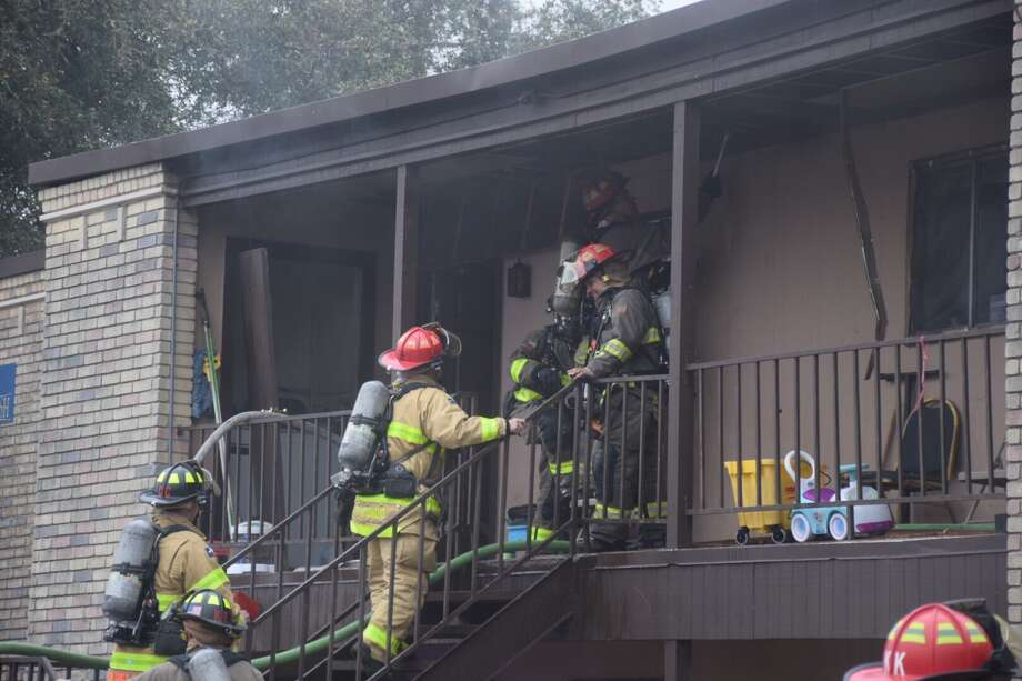 Firefighters on Tuesday, Feb. 28, 2017, responded to an apartment fire in the 700 block of Isom Road in the city's North Side. Photo: Caleb Downs / San Antonio Express-News