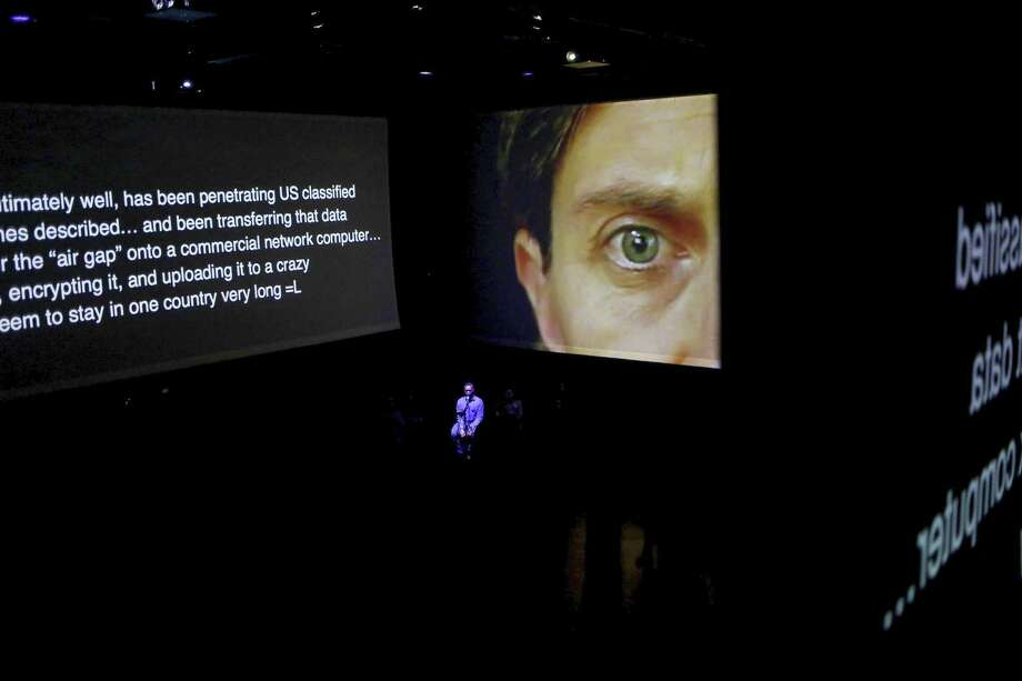 """FILE — A wall-projection from """"The Source,"""" an opera about Chelsea Manning and WikiLeaks, at the Brooklyn Academy of Music's Fishman Space in New York, Oct. 23, 2014. The opera had its premiere in 2014, but as its subject matter has evolved as a news event, """"The Source"""" has remained the same. (Kirsten Luce/The New York Times) Photo: KIRSTEN LUCE, STR / NYT / NYTNS"""