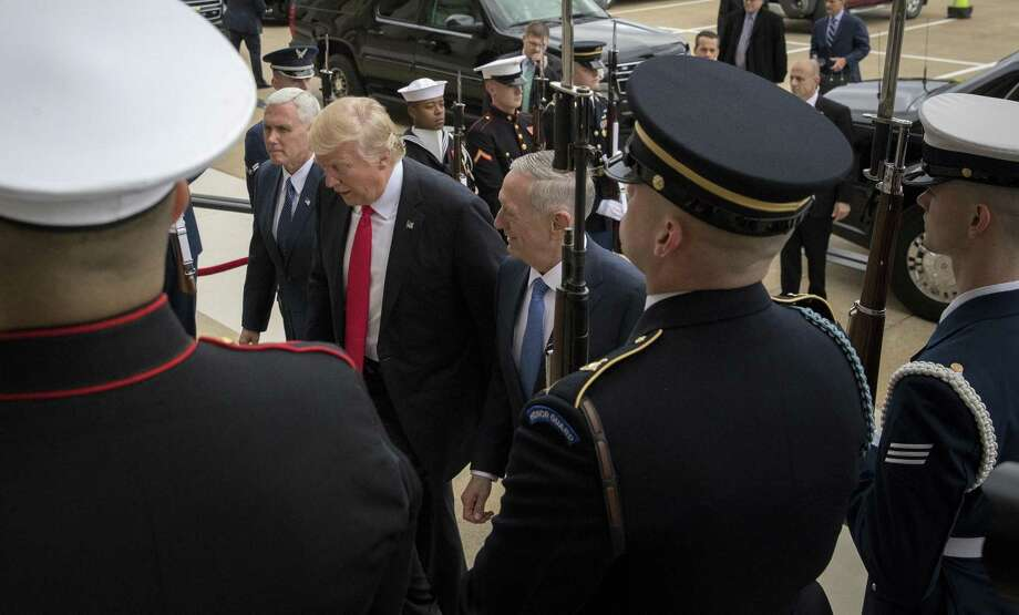 FILE -- Jim Mattis, right, with President Trump and Vice President Mike Pence, before his swearing-in as secretary of defense at the Pentagon in Washington, Jan. 27, 2017. As Mattis prepares to produce options for accelerating the fight against the Islamic State, he is balancing the need to rein in President Trump's impulses without distancing himself too much and losing White House favor. (Stephen Crowley/The New York Times) Photo: STEPHEN CROWLEY, STF / NYT / NYTNS