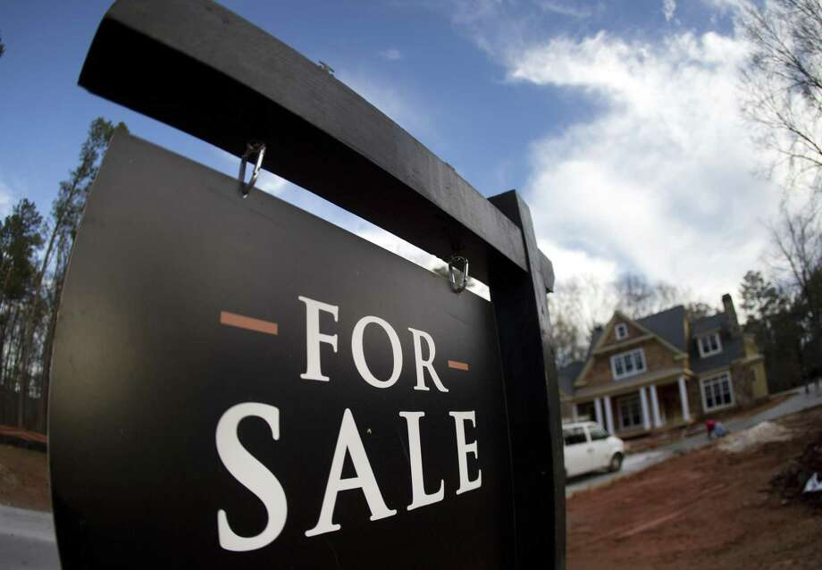 U.S. home prices rose in December from a year earlier at the fastest pace in 11 months,according to the Standard & Poor's CoreLogic Case-Shiller 20-city home price index. Photo: Associated Press /File Photo / Copyright 2016 The Associated Press. All rights reserved. This material may not be published, broadcast, rewritten or redistribu