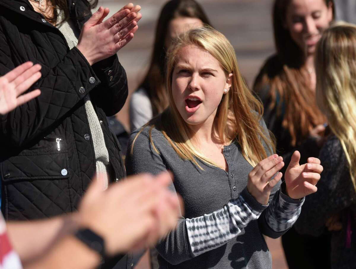 GHS senior Emma Himes applauds speakers at the #PublicSchoolProud rally in the courtyard at Greenwich High School in Greenwich, Conn. Tuesday, Feb. 28, 2017. The rally, attended by dozens of student, was a reaction to the nomination of Betsy DeVos as Secretary of Education and the recent focus on charter schools, which divert funding from public school like GHS.