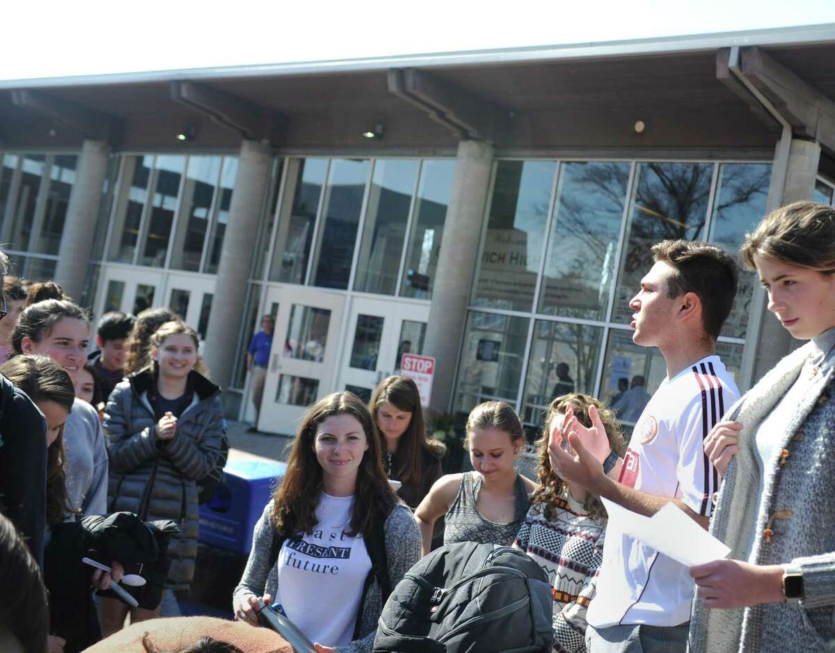 GHS senior Joseph Magliocco speaks at the #PublicSchoolProud rally in the courtyard at Greenwich High School in Greenwich, Conn. Tuesday, Feb. 28, 2017. The rally, attended by dozens of student, was a reaction to the nomination of Betsy DeVos as Secretary of Education and the recent focus on charter schools, which divert funding from public school like GHS.
