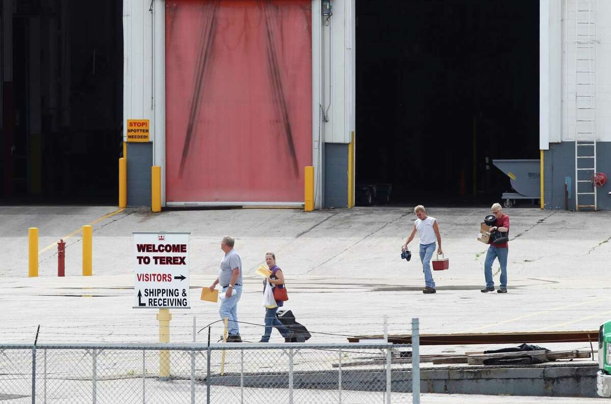 Workers leave a Terex crane manufacturing plant in Waverly, Iowa, on the final shift in July 2016 before the Westport-based company shifted production to Oklahoma City. (Matthew Putney/Waterloo Courier via AP)