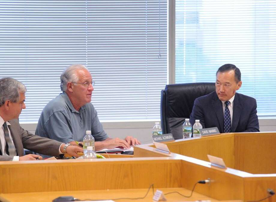 FILE — Stamford Board of Education member David Mannis, second from left, speaks during a meeting with Superintendent of Schools Earl Kim, right, at the Stamford Government Center, Conn., Tuesday night, July 26, 2016. Photo: Bob Luckey Jr. / Hearst Connecticut Media / Greenwich Time