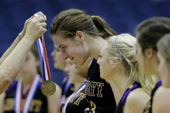 Liberty Hill's Sedona Prince (receiving medal) will play at Texas after finishing her high school career this weekend at the Alamodome.
