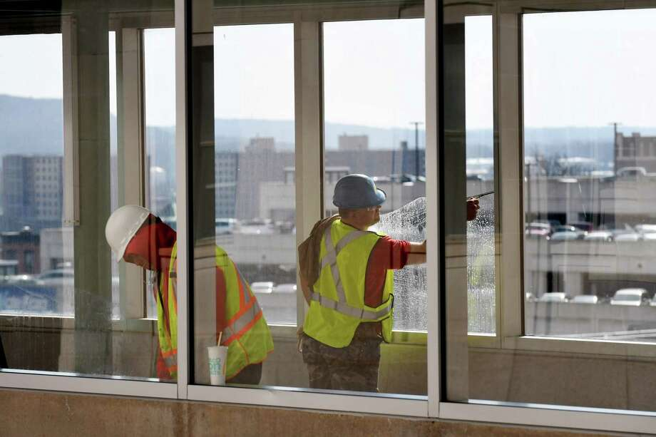 Windows are cleaned in the walkway connecting the Empire State Plaza to the Albany Capital Center and Times Union Center on Tuesday, Feb. 28, 2017, in Albany, N.Y. The Capital Center is scheduled to open this week. (Will Waldron/Times Union) Photo: Will Waldron