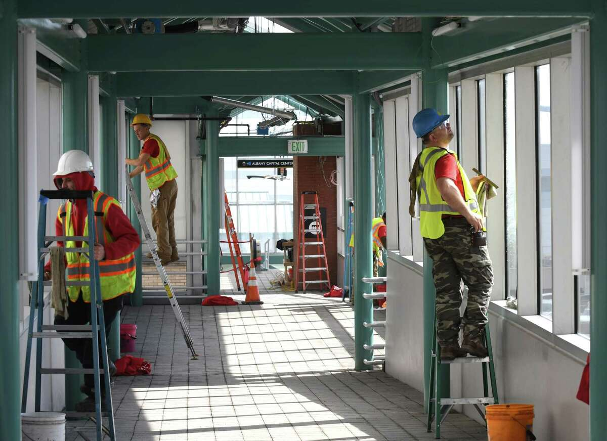 Windows are cleaned in the walkway connecting the Empire State Plaza to the Albany Capital Center and Times Union Center on Tuesday, Feb. 28, 2017, in Albany, N.Y. The Capital Center is scheduled to open this week. (Will Waldron/Times Union)