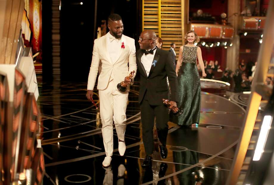 HOLLYWOOD, CA - FEBRUARY 26:  Screenwriter Tarell Alvin McCraney (L) and writer/director Barry Jenkins accept the Best Adapted Screenplay award for 'Moonlight' onstage during the 89th Annual Academy Awards at Hollywood & Highland Center on February 26, 2017 in Hollywood, California.  (Photo by Christopher Polk/Getty Images) Photo: Christopher Polk, Getty Images