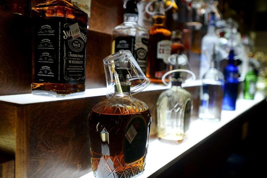 Bottles of liquor Photo: Ryan Pelham /The Enterprise / ©2015 The Beaumont Enterprise/Ryan Pelham