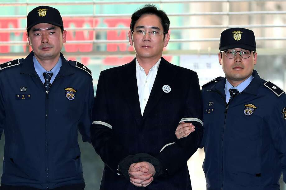 Lee Jae-yong (center) is one the most prominent business tycoons to stand trial in South Korea. Photo: SeongJoon Cho, Bloomberg