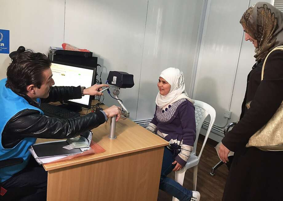A Syrian refugee, 11, poses for a biometric iris scan at the U.N. refugee agency in Jordan's capital, Amman. Photo: Karin Laub, Associated Press