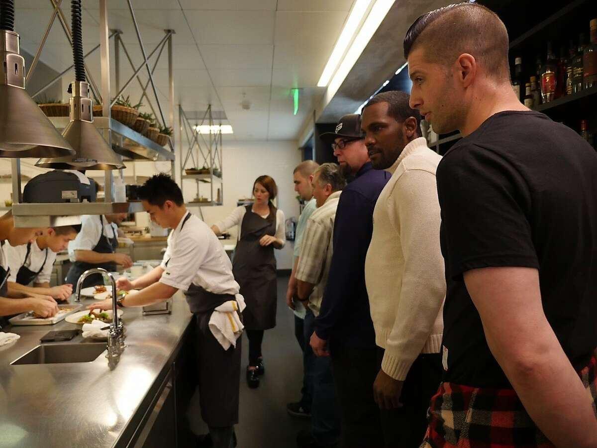 Residents of Father Alfred Center tour the In Situ kitchen