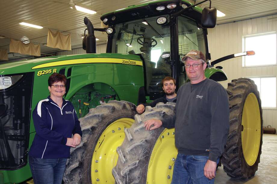 From left is Leanne Schuette; her son, Lance Schuette; and her husband, Troy Schuette. Photo: Brenda Battel/Huron Daily Tribune