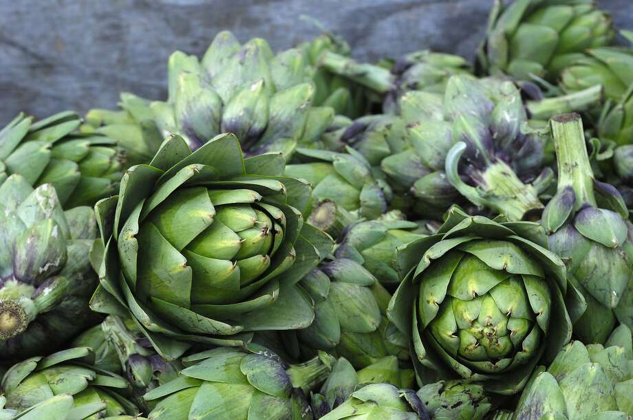Cut artichokes in a wooden bin at a roadside stand, awaiting mayonnaise. Photo: GomezDavid, Getty Images