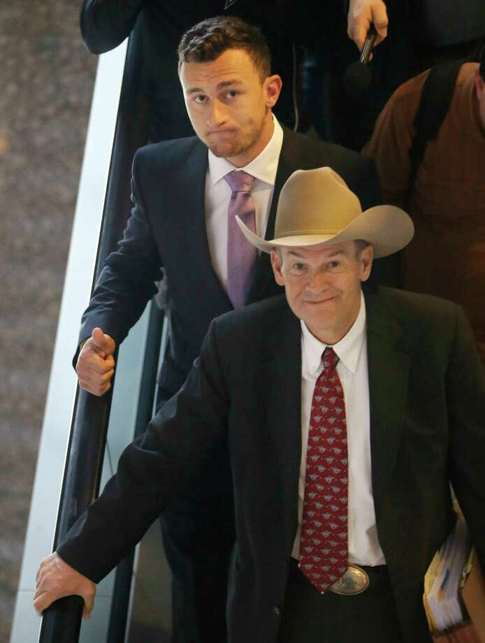 Former NFL quarterback Johnny Manziel, left, leaves a courthouse with his lawyer Jim Darnell after a hearing in Dallas, Tuesday, Feb. 28, 2017. A Dallas County judge ordered Manziel to be at the hearing to address concerned about reports that he has violated terms of a plea agreement for a domestic violence case. (AP Photo/LM Otero) Photo: LM Otero, Associated Press / Copyright 2017 The Associated Press. All rights reserved.