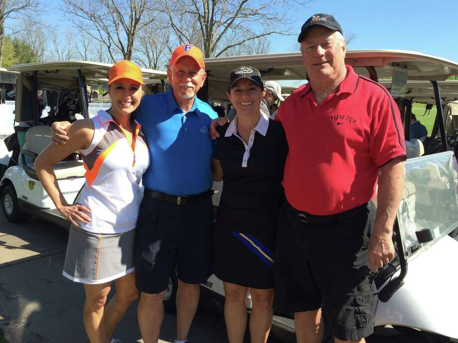 Jennifer Ramsey, from left. group exercise instructor at Monty Ballard YMCA, Ralph Fluker and Melanie Ellis, past board members for Katy Area YMCAs, and Bill Griffin, current Katy Area YMCA board member, pose after last year's Spring Golf Classic Tournament. This year's Spring Golf Classic Tournament will be March 27. Photo: YMCA Of Greater Houston